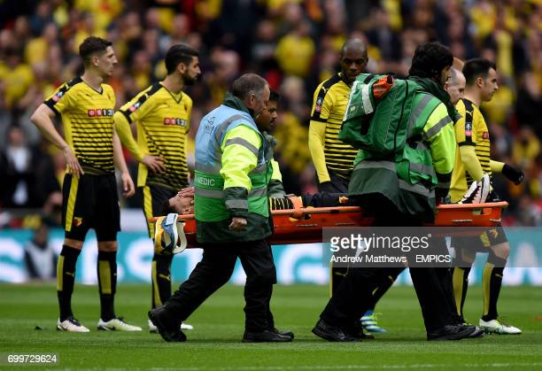 Watford's Etienne Capoue is carried off the pitch on a stretcher