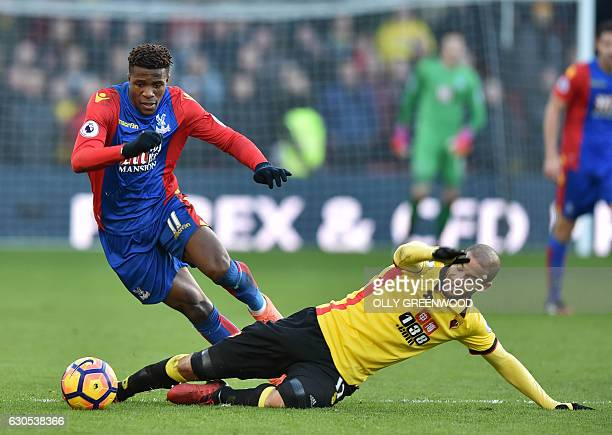 Watford's French midfielder Adlene Guedioura vies with Crystal Palace's Ivorianborn English striker Wilfried Zaha during the English Premier League...