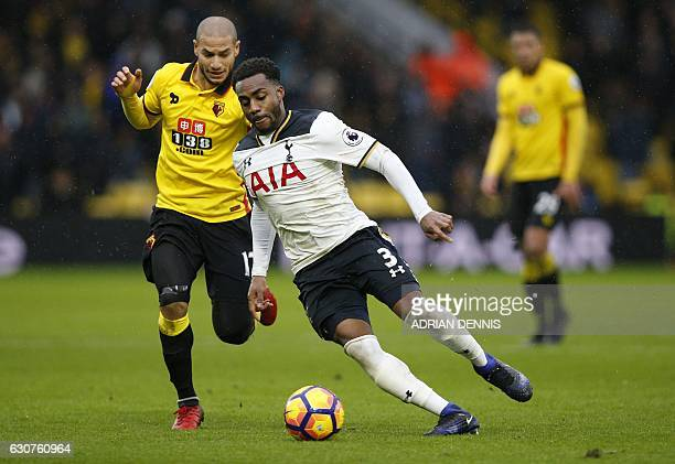 Watford's French midfielder Adlene Guedioura vies with Tottenham Hotspur's English defender Danny Rose during the English Premier League football...