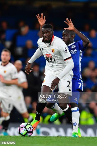 Watford's French striker M'Baye Niang holds off Chelsea's French midfielder N'Golo Kante during the English Premier League football match between...