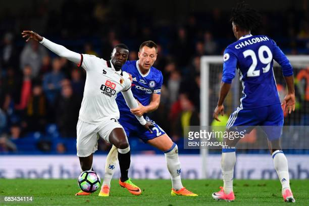 Watford's French striker M'Baye Niang tries to hold off Chelsea's English defender John Terry during the English Premier League football match...