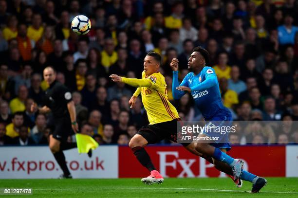 Watford's Germanborn Greek midfielder José Holebas and Arsenal's Nigerian striker Alex Iwobi chase the ball during the English Premier League...