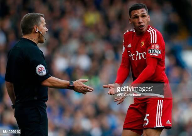 Watford's Germanborn Greek midfielder José Holebas remonstrates with referee Jon Moss during the English Premier League football match between...