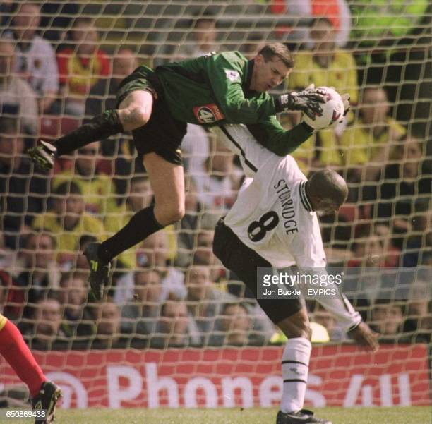 Watford's goalkeeper Alec Chamberlain is acrobatic as he takes control of the ball from a challenge from Derby's Dean Sturridge