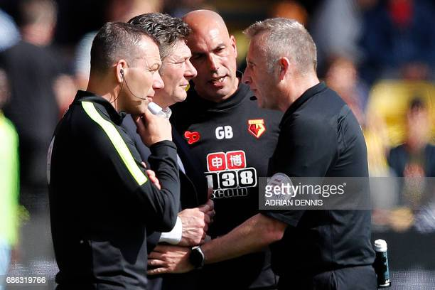 Watford's Italian head coach Walter Mazzarri talks with officials during the English Premier League football match between Watford and Manchester...