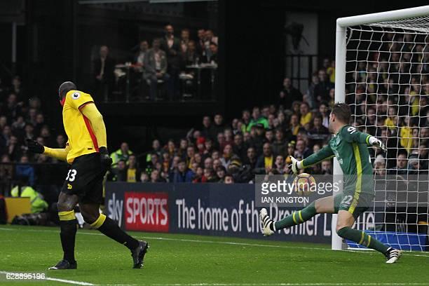 Watford's Italian striker Stefano Okaka shoots and scores past Everton's Dutch goalkeeper Maarten Stekelenburg during the English Premier League...