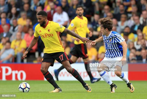 Watford's Jerome Sinclair and Real Sociedad's Alvaro Odriozola battle for the ball during the preseason friendly match at Vicarage Road Watford