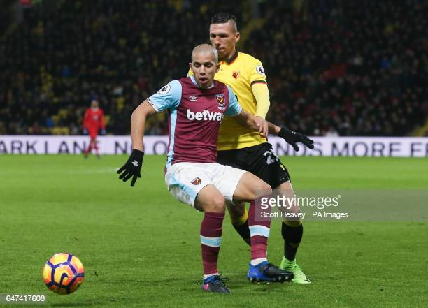 Watford's Jose Holebas and West Ham's Sofiane Feghouli during the Premier League match at Vicarage Road Watford