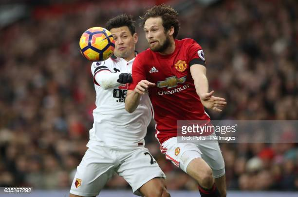 Watford's Mauro Zarate and Manchester United's Daley Blind battle for the ball