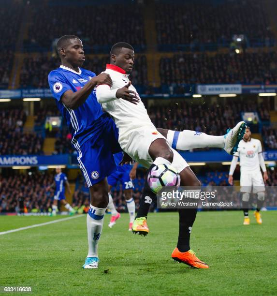 Watford's Mbaye Niang holds off the challenge from Chelsea's Kurt Zouma during the Premier League match between Chelsea and Watford at Stamford...