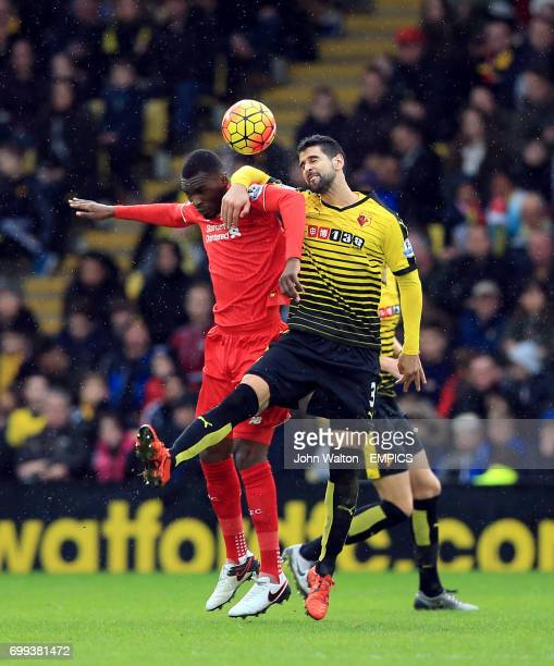 Watford's Miguel Angel Britos and Liverpool's Christian Benteke battle for the ball