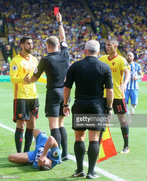 Watford's Miguel Britos receives a red card for serious foul play during the Premier League match at Vicarage Road Watford