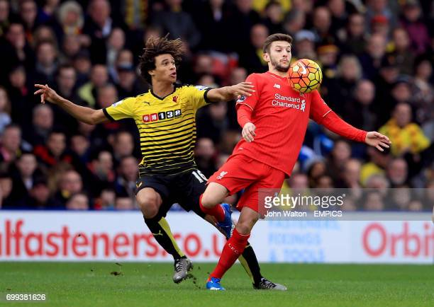 Watford's Nathan Ake and Liverpool's Adam Lallana battle for the ball