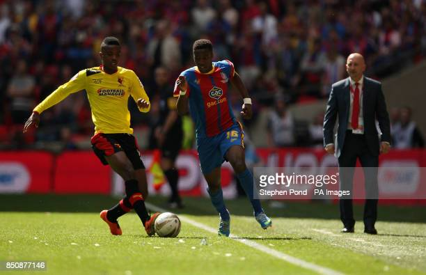 Watford's Nathaniel Chalobah and Crystal Palace's Wilfried Zaha battle for the ball as Crystal Palace Manager Ian Holloway looks on during the npower...