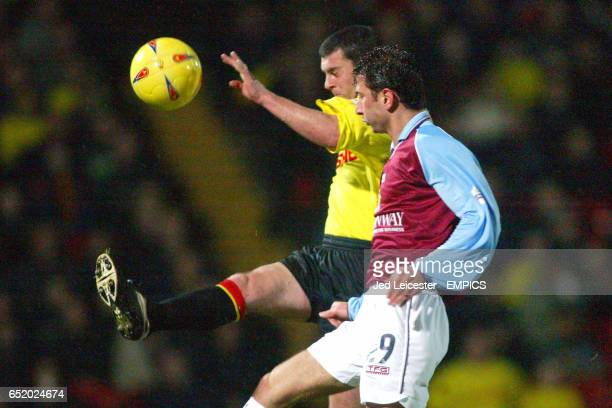 Watford's Paul Robinson boots the ball away from Burnley's Dimitrios Papadopoulos