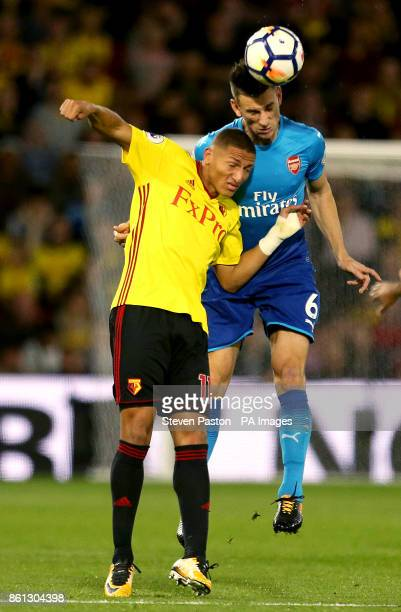 Watford's Richarlison and Arsenal's Laurent Koscielny battle for the ball during the Premier League match at Vicarage Road Watford