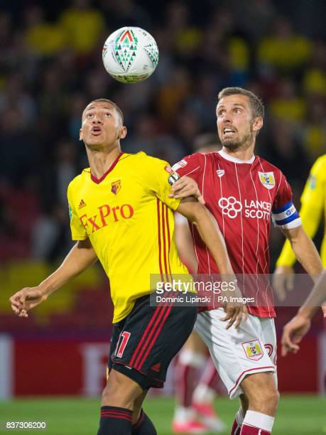 Watford's Richarlison and Bristol City's Gary O'Neill battle for the ball during the Carabao Cup Second Round match at Vicarage Road Watford