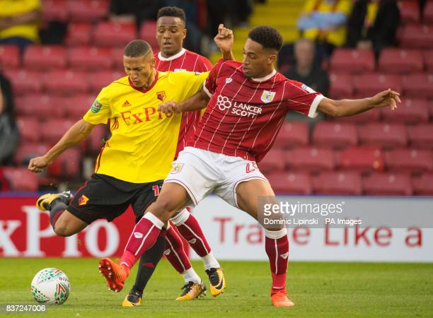 Watford's Richarlison and Bristol City's Zak Vyner battle for the ball during the Carabao Cup Second Round match at Vicarage Road Watford