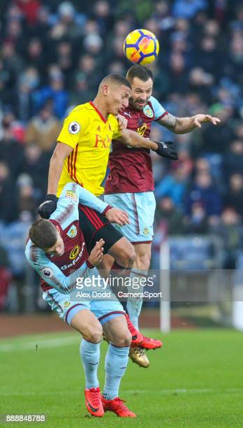 Watford's Richarlison battles with Burnley's Phillip Bardsley and Johann Gudmundsson during the Premier League match between Burnley and Watford at...