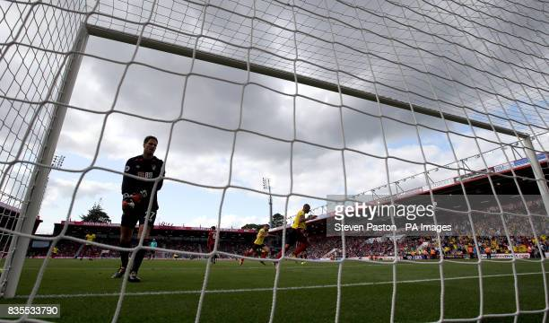 Watford's Richarlison celebrates scoring his side's first goal of the game as AFC Bournemouth goalkeeper Asmir Begovic stands dejected during the...