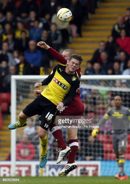 Watford's Sean Murray clashes in the air with Derby's Jake Buxton during the Sky Bet Championship match at Vicarage Road Watford