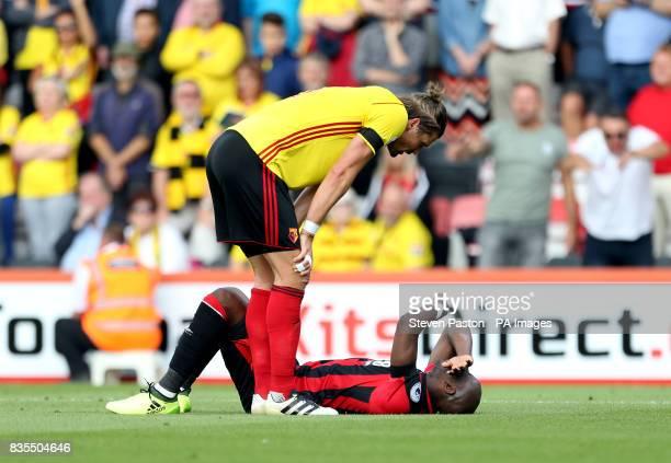 Watford's Sebastian Prodl checks on AFC Bournemouth's Benik Afobe during the Premier League match at the Vitality Stadium Bournemouth