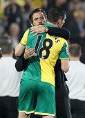 Watford's Spanish manager Quique Sanchez Flores embraces Norwich City's Scottish midfielder Graham Dorrans after the English Premier League football...