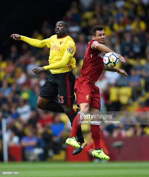 Watford's Stefano Okaka and Liverpool's Dejan Lovren battle for the ball during the Premier League match at Vicarage Road Watford