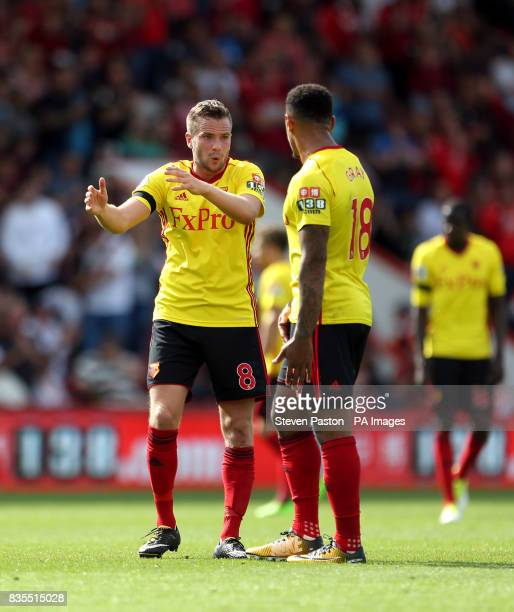 Watford's Tom Cleverley and Andre Gray have a discussion during the Premier League match at the Vitality Stadium Bournemouth