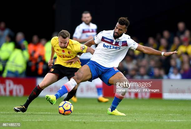 Watford's Tom Cleverley and Stoke City's Eric Maxim ChoupoMoting battle for the ball during the Premier League match at Vicarage Road Watford