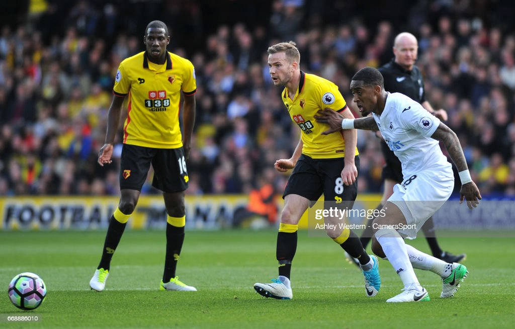 Watford's Tom Cleverley holds off the challenge from Swansea City's Leroy Fer during the Premier League match between Watford and Swansea City at Vicarage Road on April 15, 2017 in Watford, England.