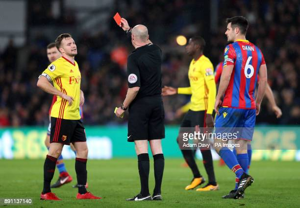 Watford's Tom Cleverley is shown a red card by referee Lee Mason during the Premier League match at Selhurst Park London