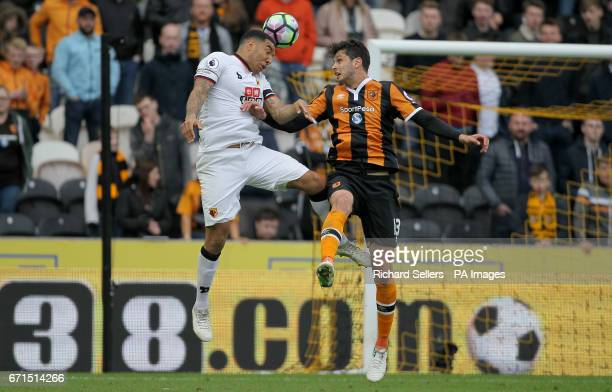 Watford's Troy Deeney and Hull City's Andrea Ranocchia battle for the ball in the air during the Premier League match at the KCOM Stadium Hull