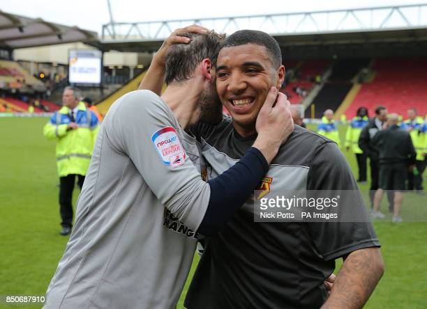 Watford's Troy Deeney and Manuel Almunia celebrate on the pitch after the final whistle