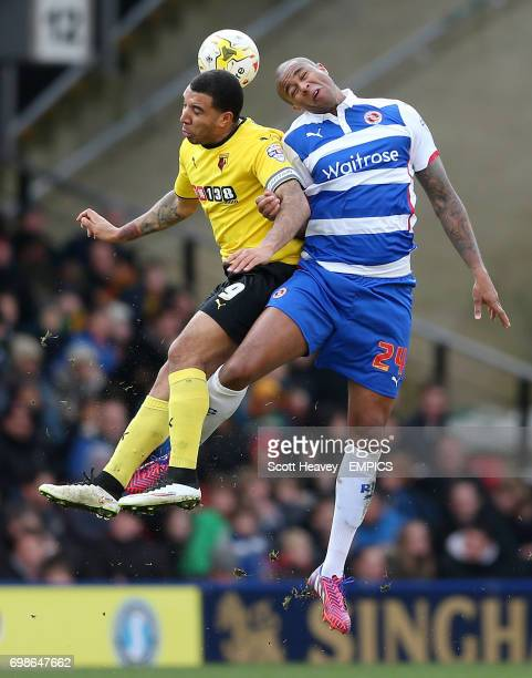 Watford's Troy Deeney and Reading's Zat Knight in action