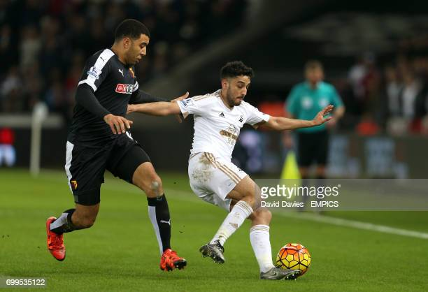 Watford's Troy Deeney and Swansea City's Neil Taylor in action