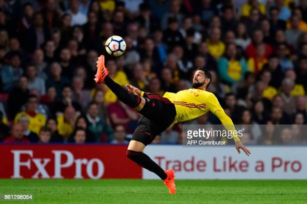 Watford's Uruguayan defender Miguel Britos plays the ball during the English Premier League football match between Watford and Arsenal at Vicarage...
