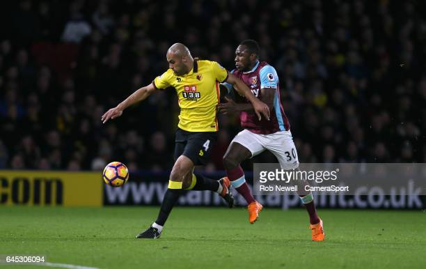 Watford's Younes Kaboul and West Ham United's Michail Antonio during the Premier League match between Watford and West Ham United at Vicarage Road on...