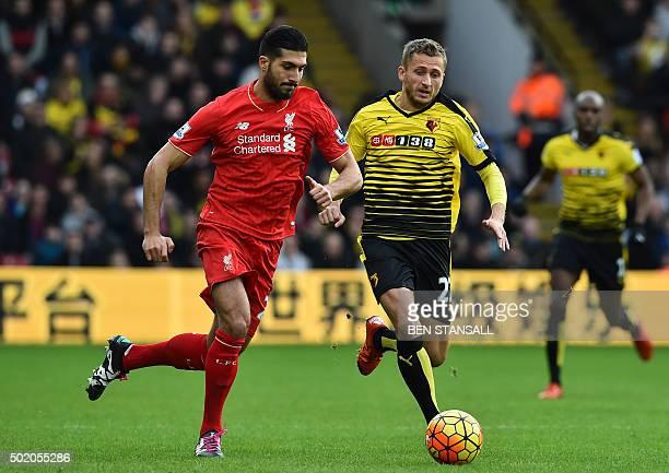 Watford's Yugoslavianborn Swiss midfielder Almen Abdi vies with Liverpool's German midfielder Emre Can during the English Premier League football...