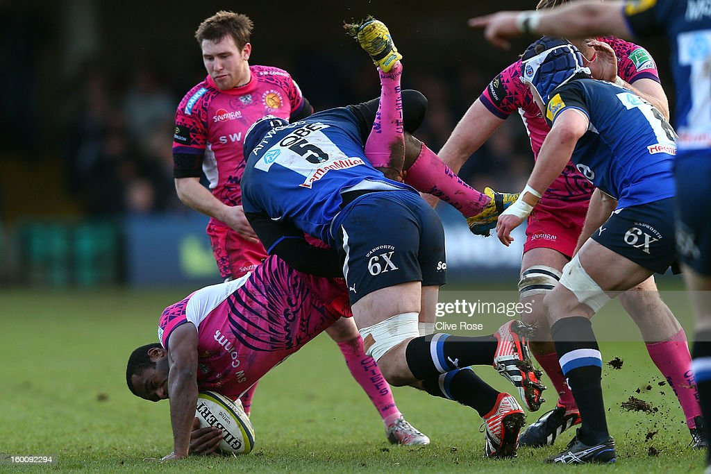 Watisoni Votu of Exeter Chiefs is tackled by <a gi-track='captionPersonalityLinkClicked' href=/galleries/search?phrase=Dave+Attwood&family=editorial&specificpeople=4134653 ng-click='$event.stopPropagation()'>Dave Attwood</a> of Bath during the LV= Cup match between Bath and Exeter Chiefs at the Recreation Ground on January 26, 2013 in Bath, England.