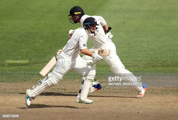 BJ Watling and Colin de Grandhomme of New Zealand run between the wickets during day four of the third Test cricket match between New Zealand and...
