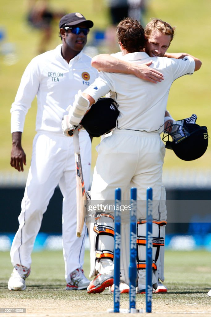 BJ Watling and Kane Williamson of New Zealand embrace at the end of day four of the Second Test match between New Zealand and Sri Lanka at Seddon Park on December 21, 2015 in Hamilton, New Zealand.