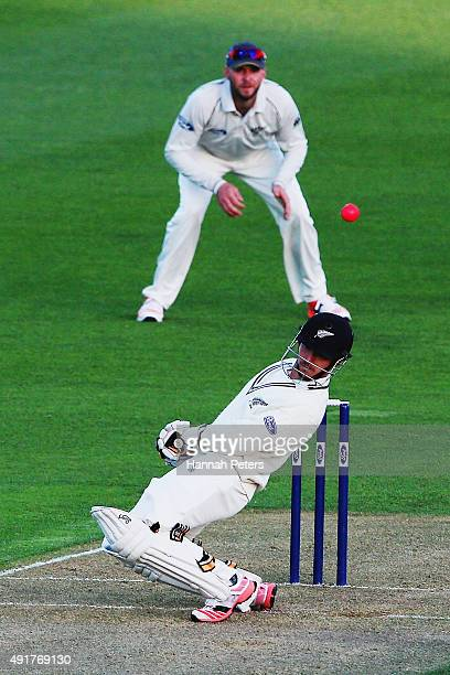 Watling avoids a bouncer from the new pink cricket ball during a New Zealand cricket training session at Seddon Park on October 8 2015 in Hamilton...