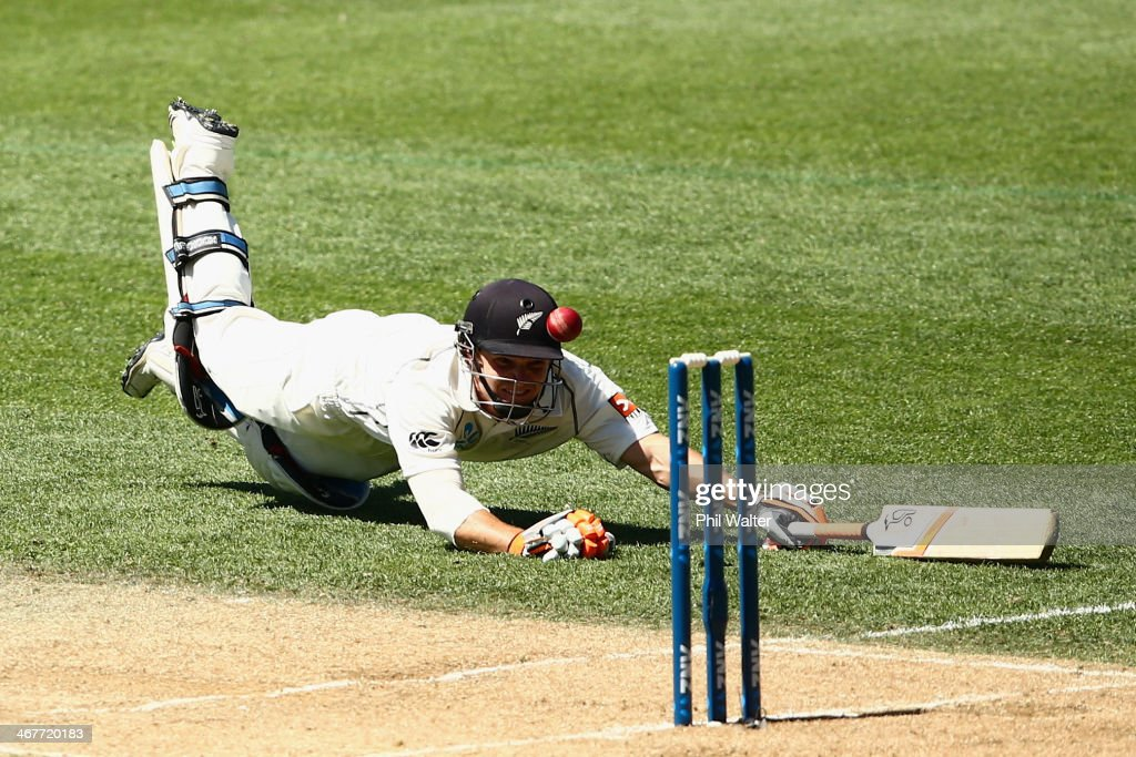 <a gi-track='captionPersonalityLinkClicked' href=/galleries/search?phrase=BJ+Watling&family=editorial&specificpeople=2115739 ng-click='$event.stopPropagation()'>BJ Watling</a> dives into his crease during day three of the First Test match between New Zealand and India at Eden Park on February 8, 2014 in Auckland, New Zealand.