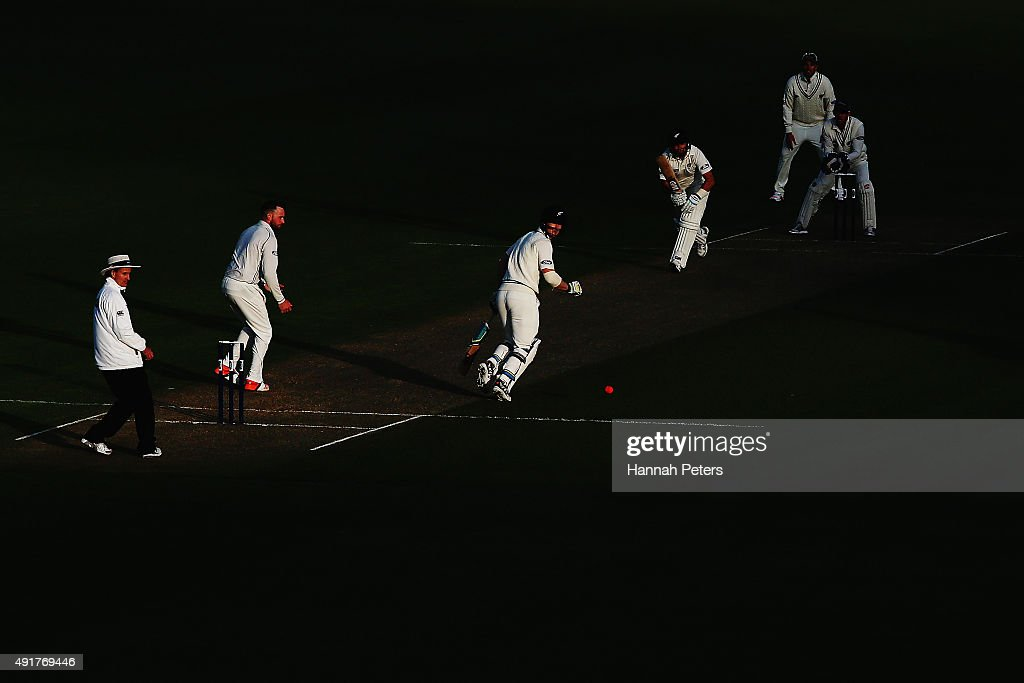 <a gi-track='captionPersonalityLinkClicked' href=/galleries/search?phrase=BJ+Watling&family=editorial&specificpeople=2115739 ng-click='$event.stopPropagation()'>BJ Watling</a> drives the pink cricket ball down the pitch as James Neesham sets off for a run during a New Zealand cricket training session at Seddon Park on October 8, 2015 in Hamilton, New Zealand. The new pink ball will be used during the upcoming test series against Australia.