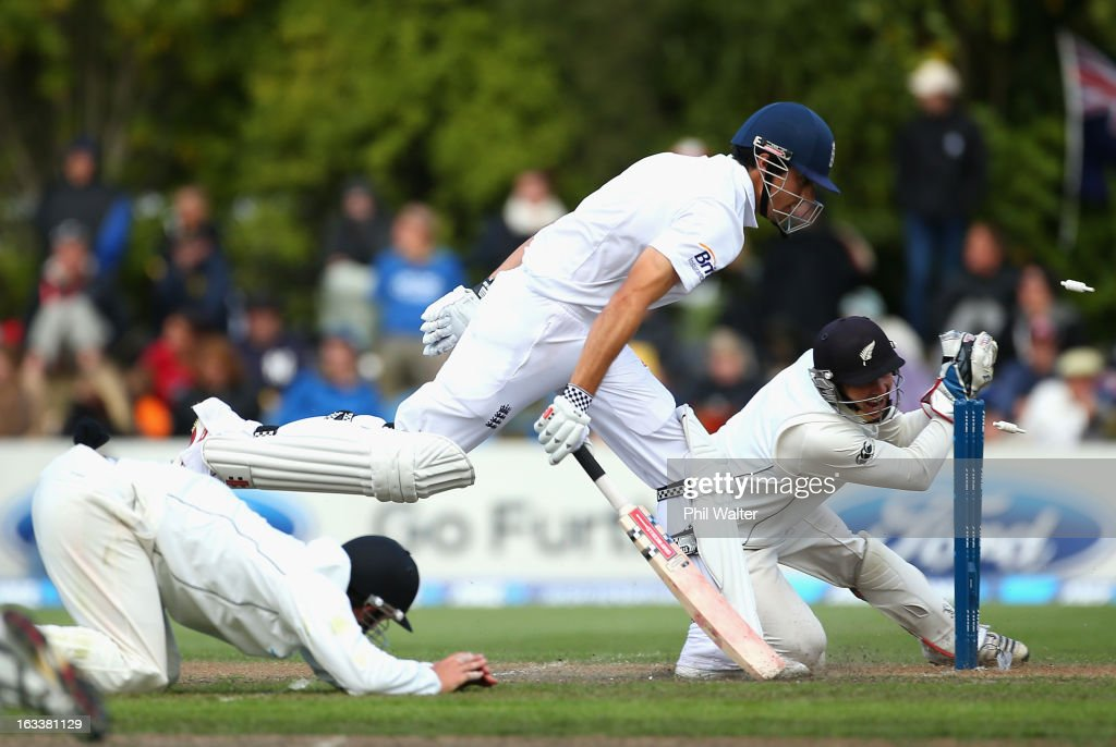 <a gi-track='captionPersonalityLinkClicked' href=/galleries/search?phrase=BJ+Watling&family=editorial&specificpeople=2115739 ng-click='$event.stopPropagation()'>BJ Watling</a> of New Zealand attempts to run out <a gi-track='captionPersonalityLinkClicked' href=/galleries/search?phrase=Alastair+Cook+-+Cricket+Player&family=editorial&specificpeople=571475 ng-click='$event.stopPropagation()'>Alastair Cook</a> of England during day four of the First Test match between New Zealand and England at University Oval on March 9, 2013 in Dunedin, New Zealand.