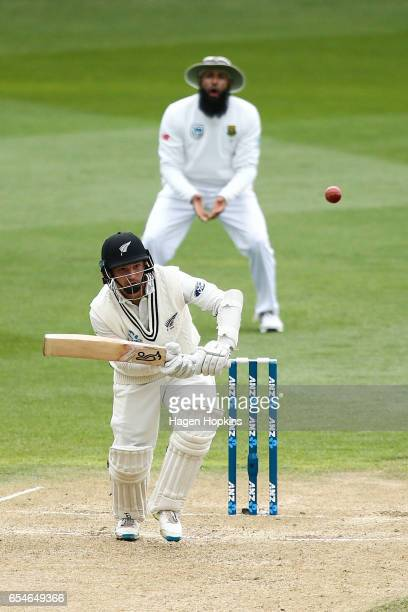 Watling of New Zealand bats while Hashim Amla of South Africa looks on during day three of the test match between New Zealand and South Africa at...