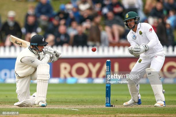 Watling of New Zealand bats while Quentin de Kock of South Africa looks on during day three of the test match between New Zealand and South Africa at...