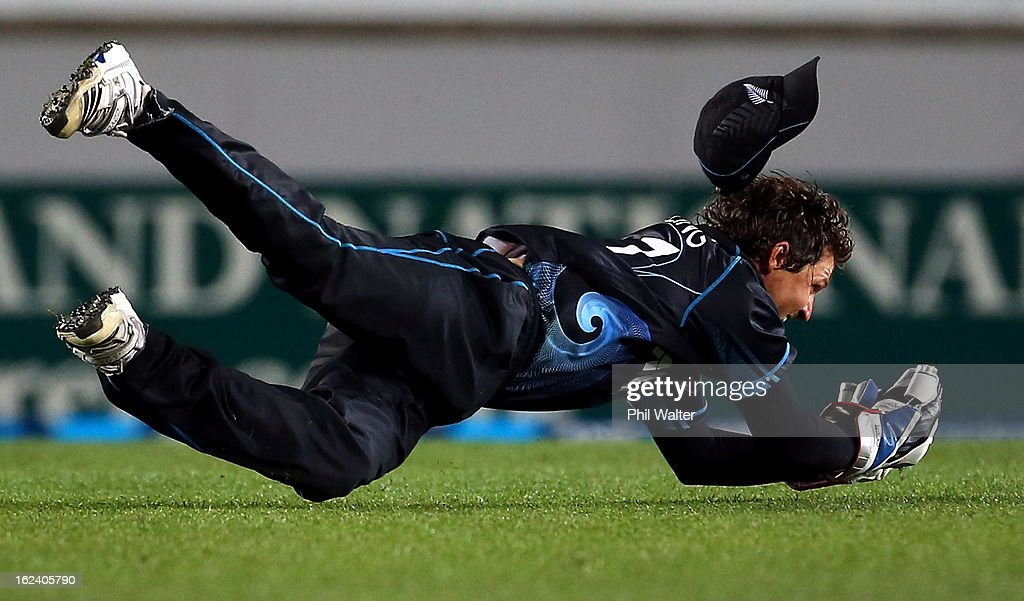 Watling of New Zealand dives to catch out Jos Buttler of England during the third game in the International One Day series between New Zealand and...