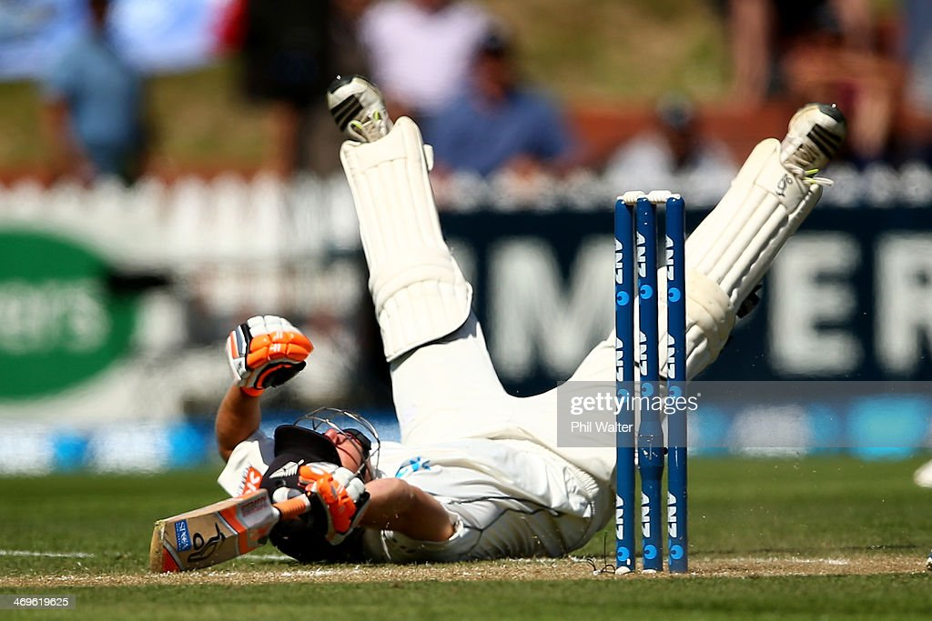 Watling of New Zealand dives to make his crease during day three of the 2nd Test match between New Zealand and India at the Basin Reserve on February...